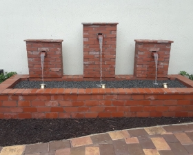 Water Feature Design with Hardscaping and Retaining Walls